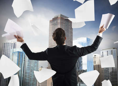 exult: Successful man exults and throws work documents