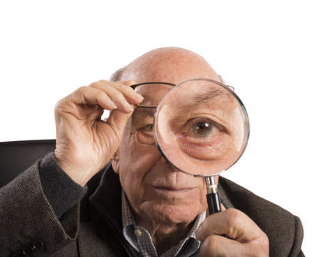 tries: Elder magnifies and tries with magnifying glass