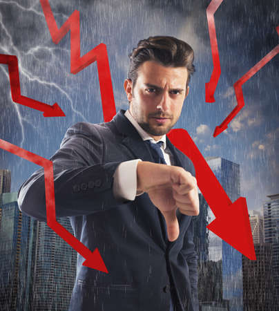 losers: Negative businessman with storm red arrows down