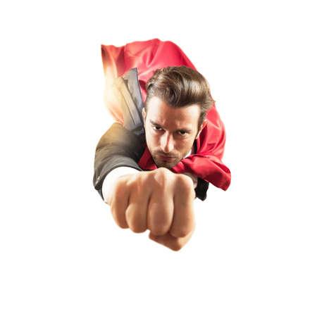 Businessman superhero flies faster in the sky Standard-Bild
