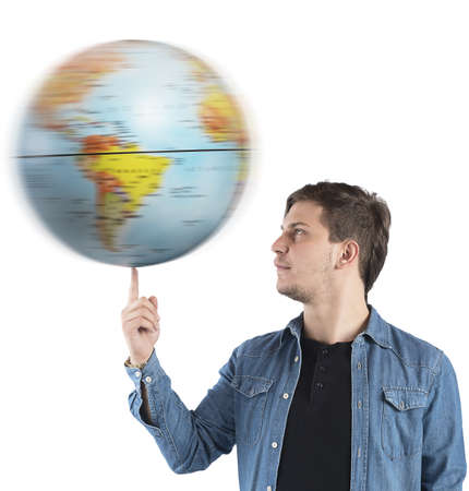 turns: Boy turns the globe with a finger