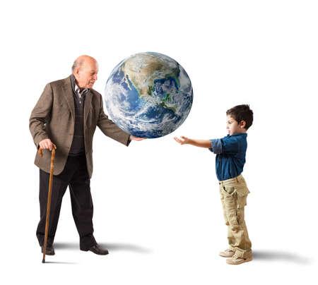 若い人たちの世界に手を提供します。地球 NASA によって提供されます。 写真素材