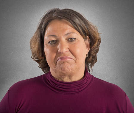 burdensome: Portrait of woman with a sad expression