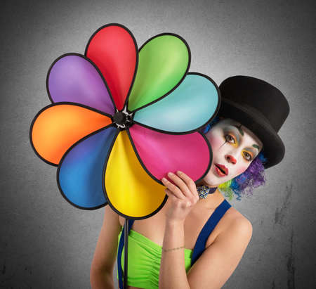 buffoon: Clown posing with a helix toy colored
