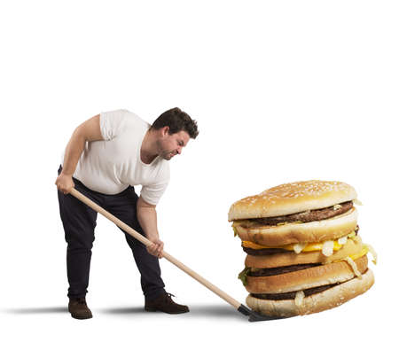 corpulent: Man lifts with shovel a giant sandwich