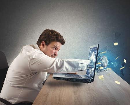 仕事からのストレスのビジネスマンを与えるパンチ 写真素材