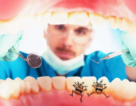 Dentist in a oral visit sees germs Archivio Fotografico