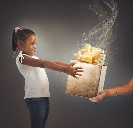 unexpected: Little girl receives a magic present sparkling Stock Photo