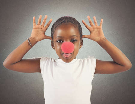 grimacing: Little girl makes grimace with red noise