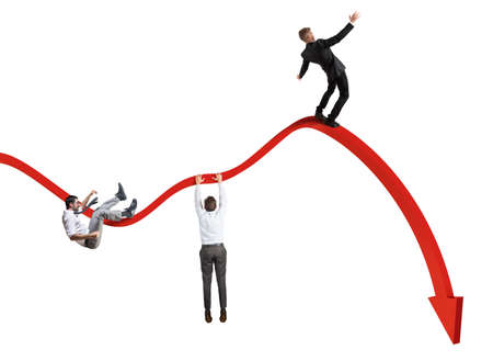 Businessmen falling down toward the economic crisis Foto de archivo