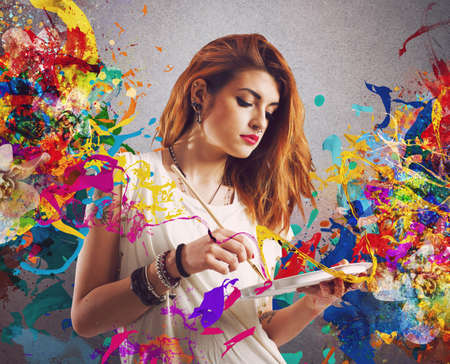 Creative woman painter with brush and palette Stock Photo