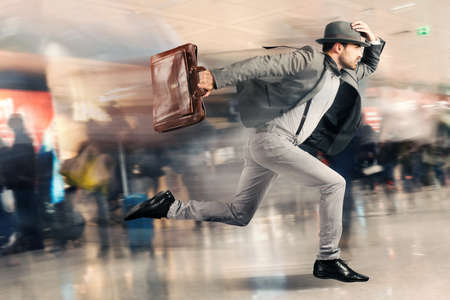 running late: Late tourist man runs fast in airport