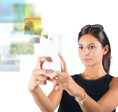 technological and communication: Girl makes pictures from her cell phone Stock Photo