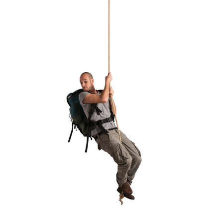 vertigo: Explorer with vertigo hanging from a rope Stock Photo