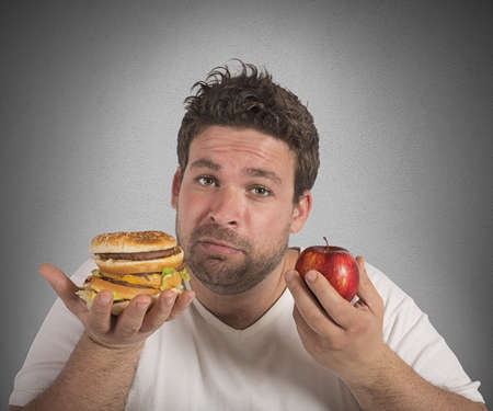 fat man: Man undecided between diet and junk food