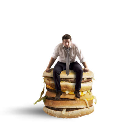 Businessman tired and hungry sitting on sandwich