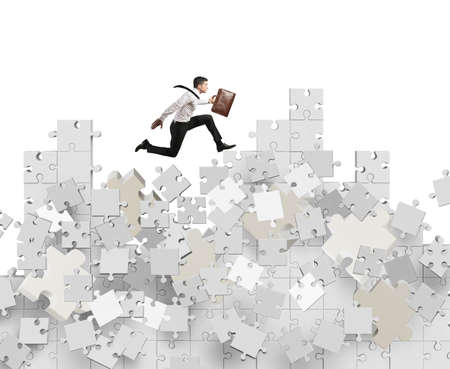 downfall: Businessman over a mountain by puzzle falling