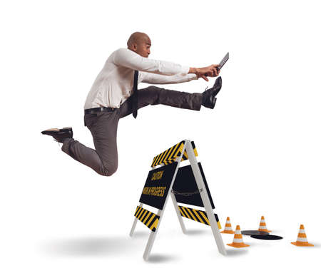 distraction: Businessman distracted trying to overcome a hazard Stock Photo