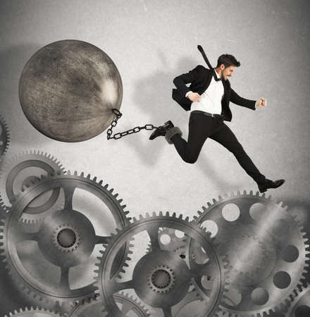 impediment: Businessman jumps between gears with an impediment Stock Photo
