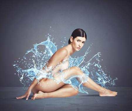 nude model: Naked girl sitting surrounded by splashing water