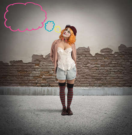 malicious: Malicious clown thinks with little colourful clouds