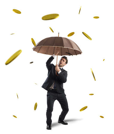 money rain: Businessman is protected by a money rain Stock Photo