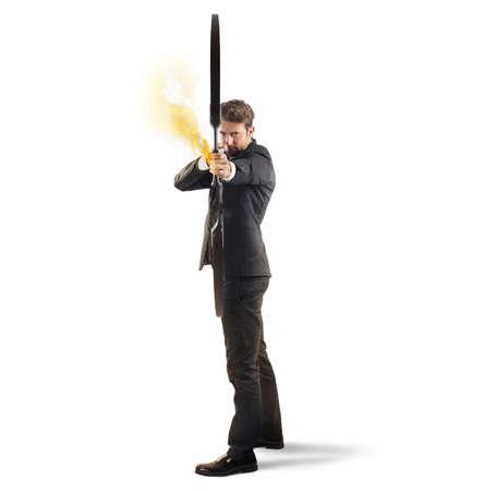 aim: Businessman with bow and arrow on fire Stock Photo