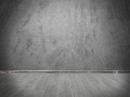Grunge background with grey wall and parquet