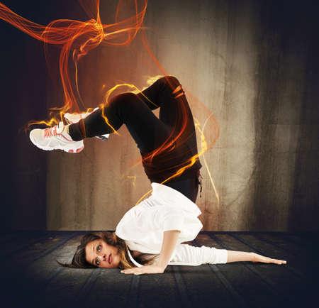 breakdancer: Agile breakdancer girl surrounded by fire effect