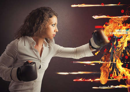 Woman fights a virus attack like fire Stock Photo