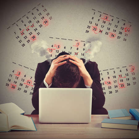 Businessman worried and stressed out by deadlines Archivio Fotografico