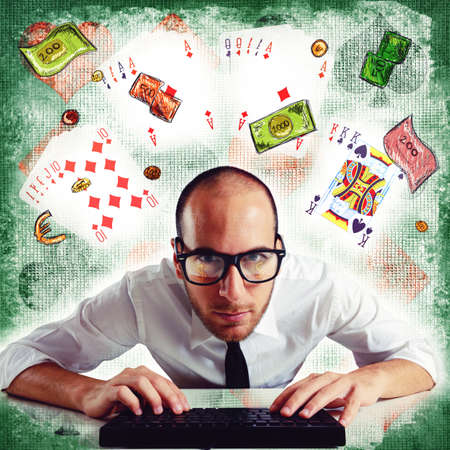 speculate: Man plays poker online on the computer