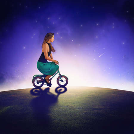 tranquil atmosphere: Girl with bike ride under the stars