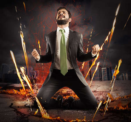 determined: Businessman rejoices triumphantly on a city collapsing