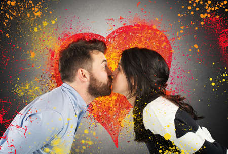 flirt: Couple kissing with splash colourful heart background