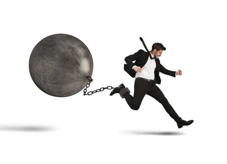 businessman jumping: Determined businessman runs despite heavy hard impediment