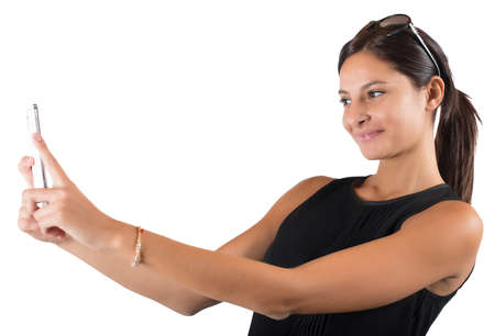 communicating: Girl with mobile phone likes to shoot Stock Photo