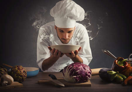 preparing food: Chef smelling the aroma of a dish