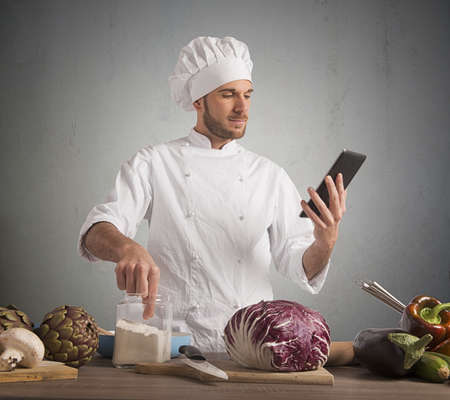 reads: Chef reads a recipe from the tablet
