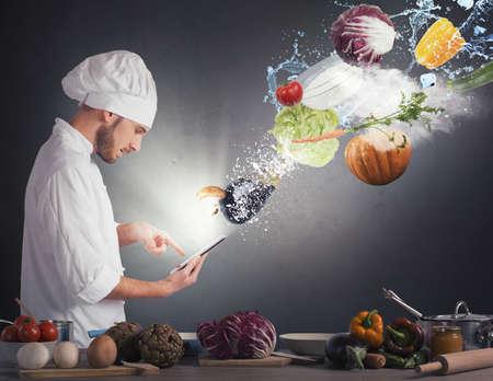 요리사는 태블릿에서 조리법을 읽고 스톡 콘텐츠 - 44585364