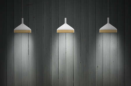 appartment: Gray empty room lit by three lamps Stock Photo