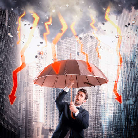 sheltered: Businessman sheltered with umbrella from lightning arrow