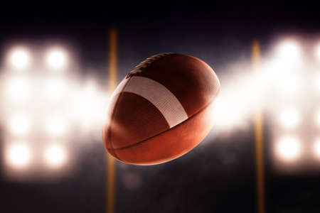 american football: Football ball flying fast through the air