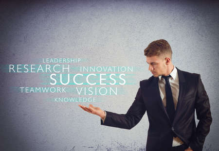 business challenge: Successful businessman with words over his hand Stock Photo