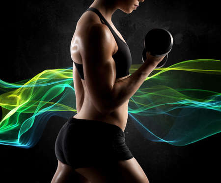 tricep: Muscular woman workout with light effect background