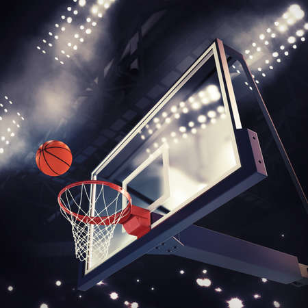 court: Ball above the basket during basketball game