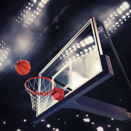 cancha de basquetbol: Bola encima de la cesta durante juego de baloncesto