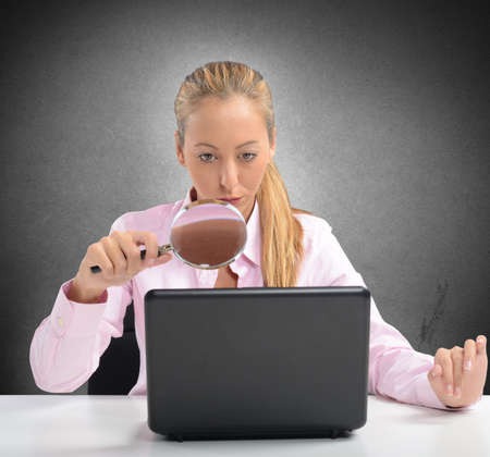 woman searching: Woman controls and protects PC as firewall Stock Photo