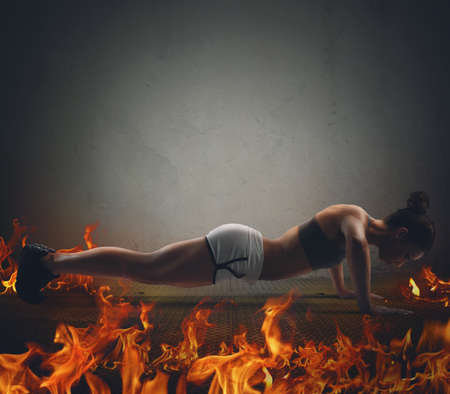 Athletic girl is training doing push up Stock Photo