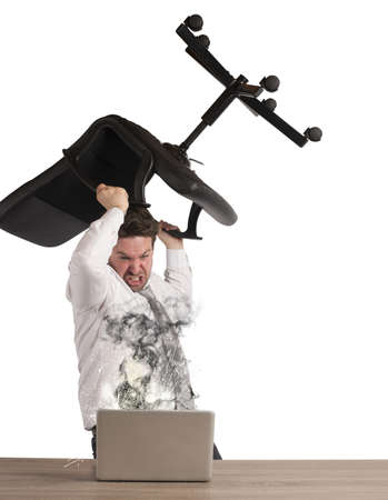 breaks: Stressed businessman breaks the computer with chair
